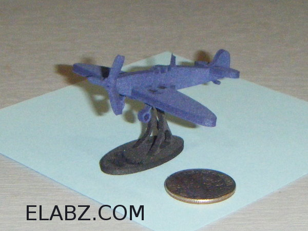 Postal stamp sized laser cut model of Supermarine Spitfire MKII