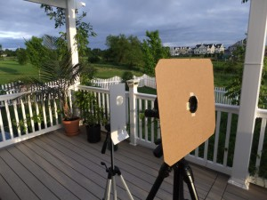 Sun viewing setup. Monocular projects the image onto a white screen.